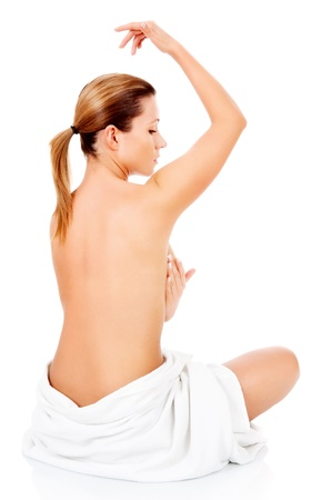 woman performing breasts examination against cancer threat