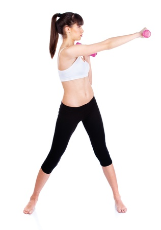 skinny girl: Young woman doing fitness exercises, isolated on white