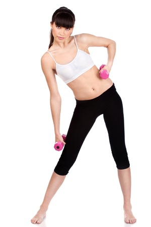 Young woman doing fitness exercises with two weights, isolated on white Stock Photo - 12369771