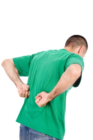 back rub: Man suffering from a kidney or back ache pain, isolated on white background Stock Photo