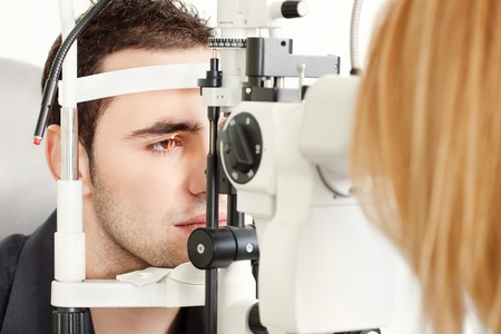 Male patient is having a medical attendance at the optometrist