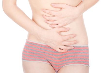 ovarios: Chica presionando su est�mago en el dolor, aislados sobre fondo blanco