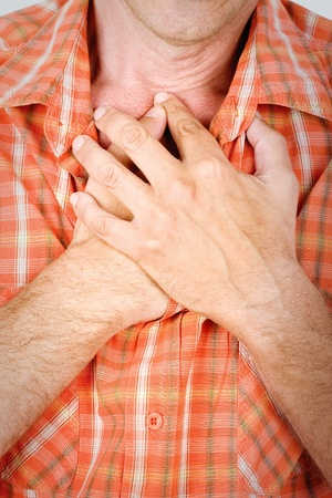 Both mans hands on chest because of hard breathing