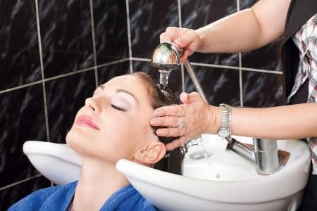 Hairdresser washing hair of customer Stock Photo