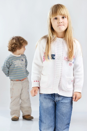 ennui: Two children, girl have face expression Stock Photo