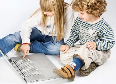 Curl hair boy and blue hair girl trying to turn on computer in front of them