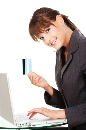 businesswoman card: Businesswoman typing on keyboard and holding credit card, isolated on white background
