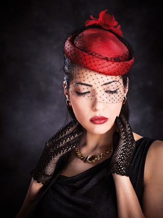 provocative women: Portrait of a pretty woman with red hat and black gloves