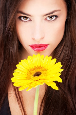 Pretty woman and yellow daisy