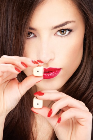 games of chance: Close up of a pretty young woman holding dices