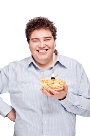 Happy young chubby man with French fries in dish, isolated on white photo
