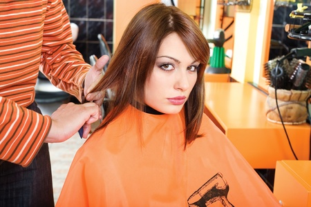 Hairdresser preparing hair for cutting photo