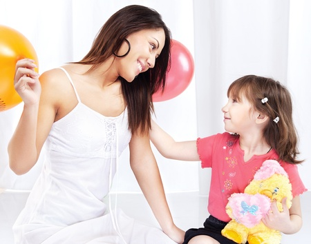 Brunette woman and child playing