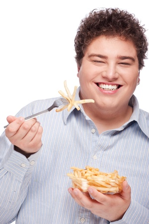 frites: Happy young chubby man with pommes frites in dish, isolate on white