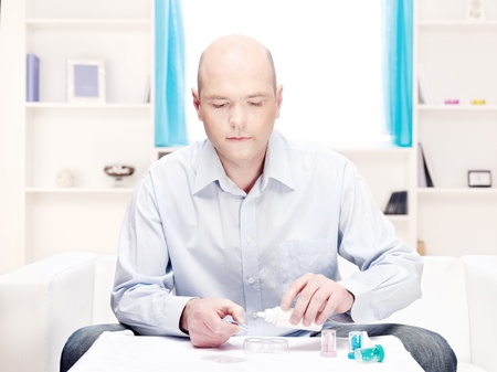 fluency: man in the home environment clean contact lens