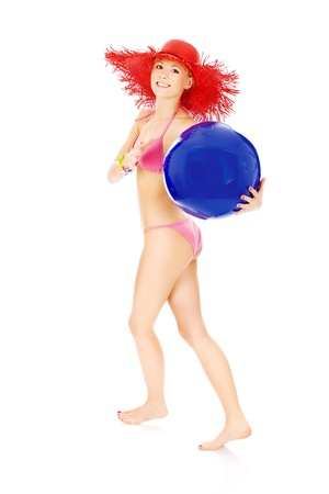 Young girl in bikini runing and hold blue ball, isolated on white background Stock Photo - 13742575