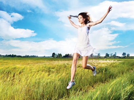 pretty woman running across field