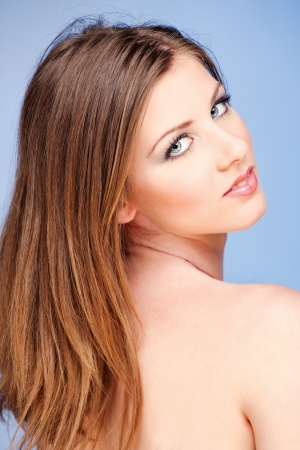 Pretty woman with blue eyes on blue background Stock Photo - 13742960