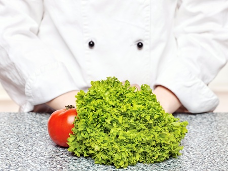lettuce and tomato on the table in front of the chefs Stock Photo - 13819185