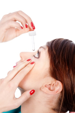 Woman putting drops in eye, isolated on white Stock Photo - 14100033