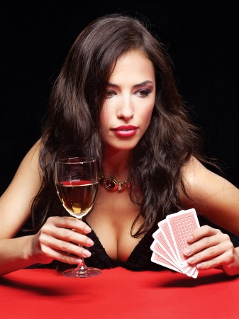 gambling game: pretty young woman gambling on red table