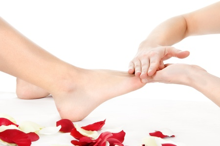 foot massage isolated on white background Stock Photo - 14099861