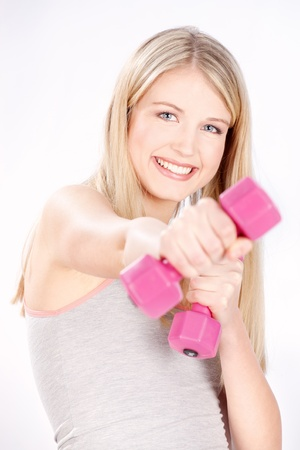 Smiled blond hair woman doing fitness exercises Stock Photo - 14099928