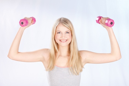 aerobic exercise: Young smiled woman doing fitness exercises
