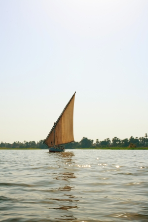 furled: Faluka on the Nile river in evening time, Egypt Stock Photo