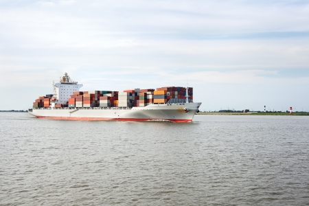 Container ship on river Elbe, Germany photo