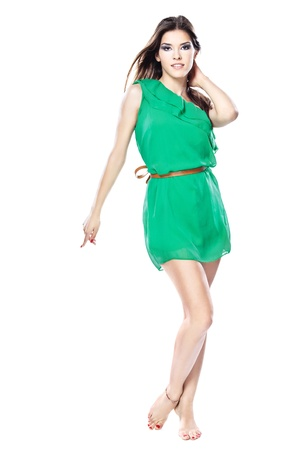 woman in green dress barefoot, isolated on white background Stock Photo - 14506839