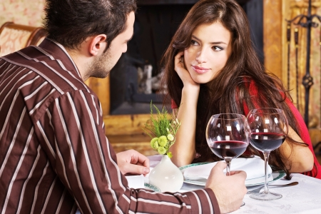 Young couple in love and red wine photo