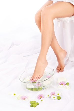 Slim legs of beautiful girl with aromatherapy bowl  Stock Photo