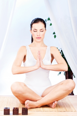 Young pretty woman at yoga relaxationmeditation photo