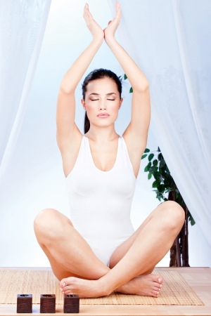 Young pretty woman at yoga relaxation photo