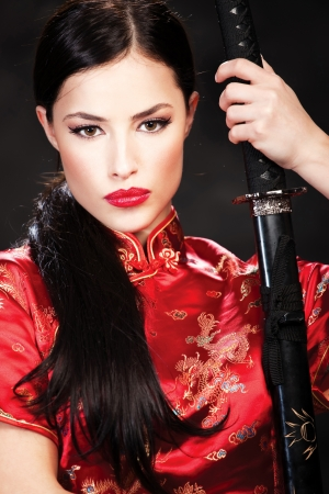 Portrait of woman with sword photo
