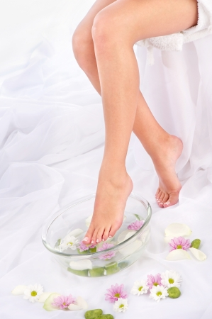 Slim legs in aromatherapy bowl, composition sided Stock Photo
