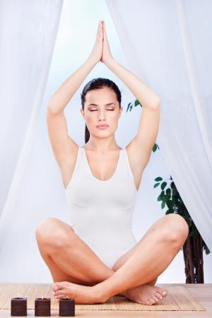 Young pretty woman at meditation photo