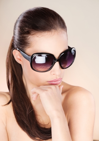 Pretty woman with big sun glasses Stock Photo - 14743228