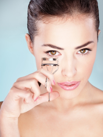 Pretty woman holding tool for eyelash Stock Photo - 14743223