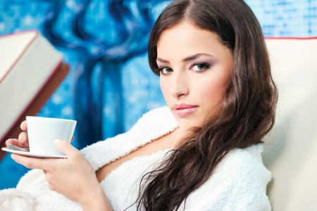 robe: Woman enjoy cup of coffee in spa center