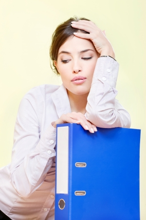 ennui: Serious or bored business woman with files Stock Photo