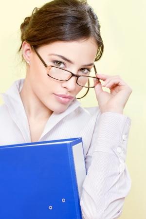 ennui: Pretty secretary with eyeglasses holding file