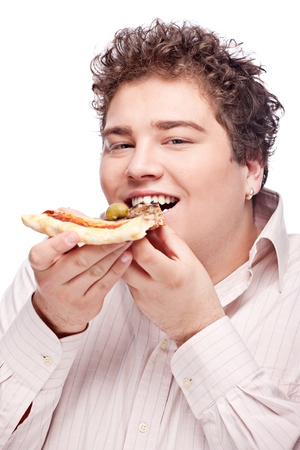 Happy chubby boy eating a slice of pizza, isolated on white photo