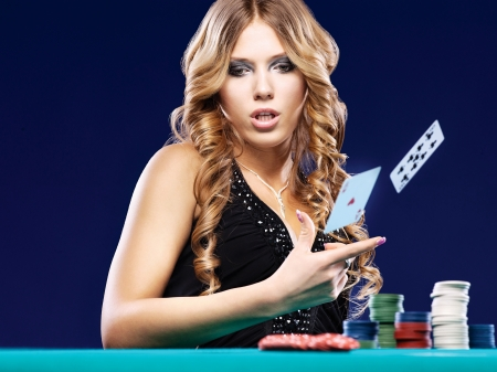Woman give up in a card gambling match on blue background photo