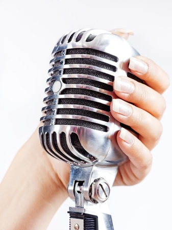 Big retro microphone in womans hand photo