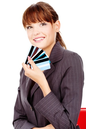Happy woman with credit cards, isolated on white background