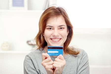 Happy young woman can on line shopping with credit card Stock Photo