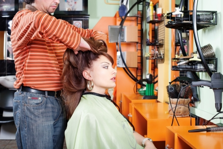 short haircut: Hairdresser give a had massage to his customer in hair salon