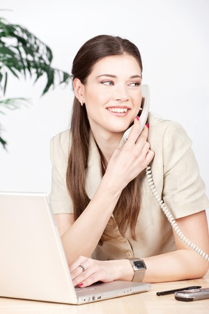 Business woman doing phone call in the office Stock Photo - 14880912